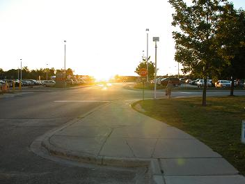 photo of low sun obscuring stop sign